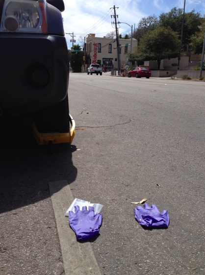 "Discarded EMS worker gloves the morning after the SXSW crash on Red River. James Shamard of Austin-Travis EMS said that the five ""very critical"" victims were headed to hospitals within 15 minutes of the crash."
